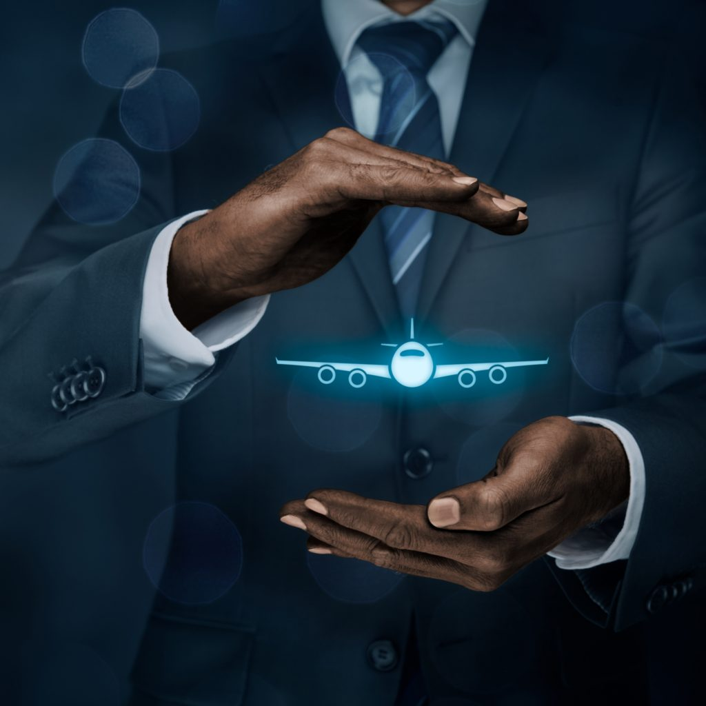 Travel insurance concept. Insurance agent or businessman with protective gesture and icon of plane. Quiet Skies by TSA concept.